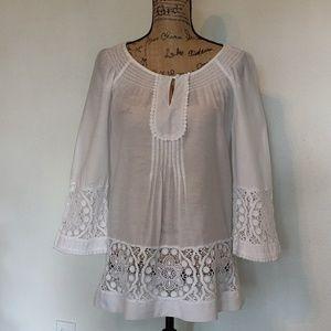 White cotton blouse sz.s with crochet detail.